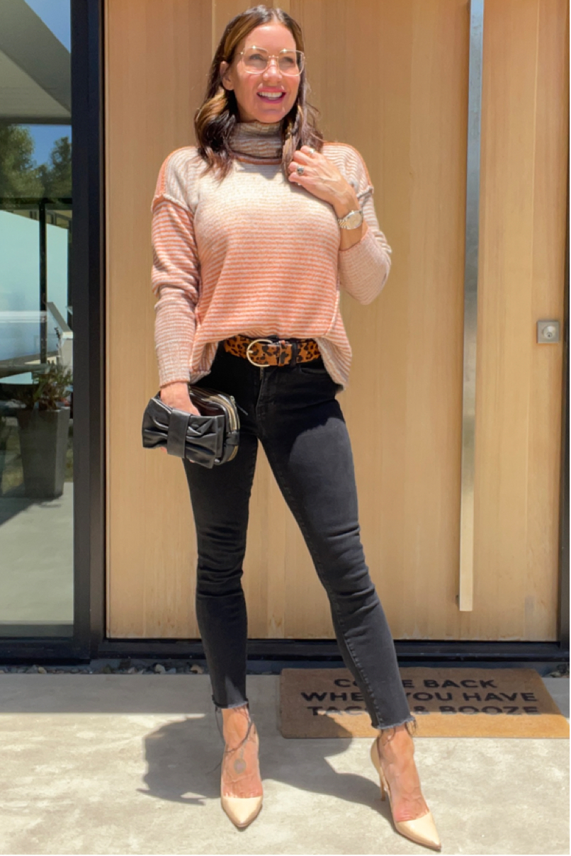 Kat Woodside, Chief Design Officer models her outfit of the day featuring the Ombré Pullover in Ombré Rose and statement accessories.
