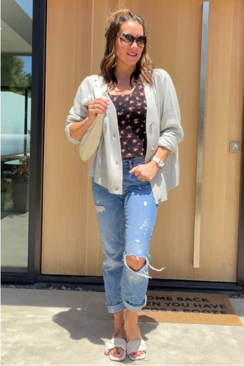 Kat Woodside, Chief Design Officer models her outfit of the day featuring the Lean Tank in Flower Burst and Snug Cardigan in Heather Gray.
