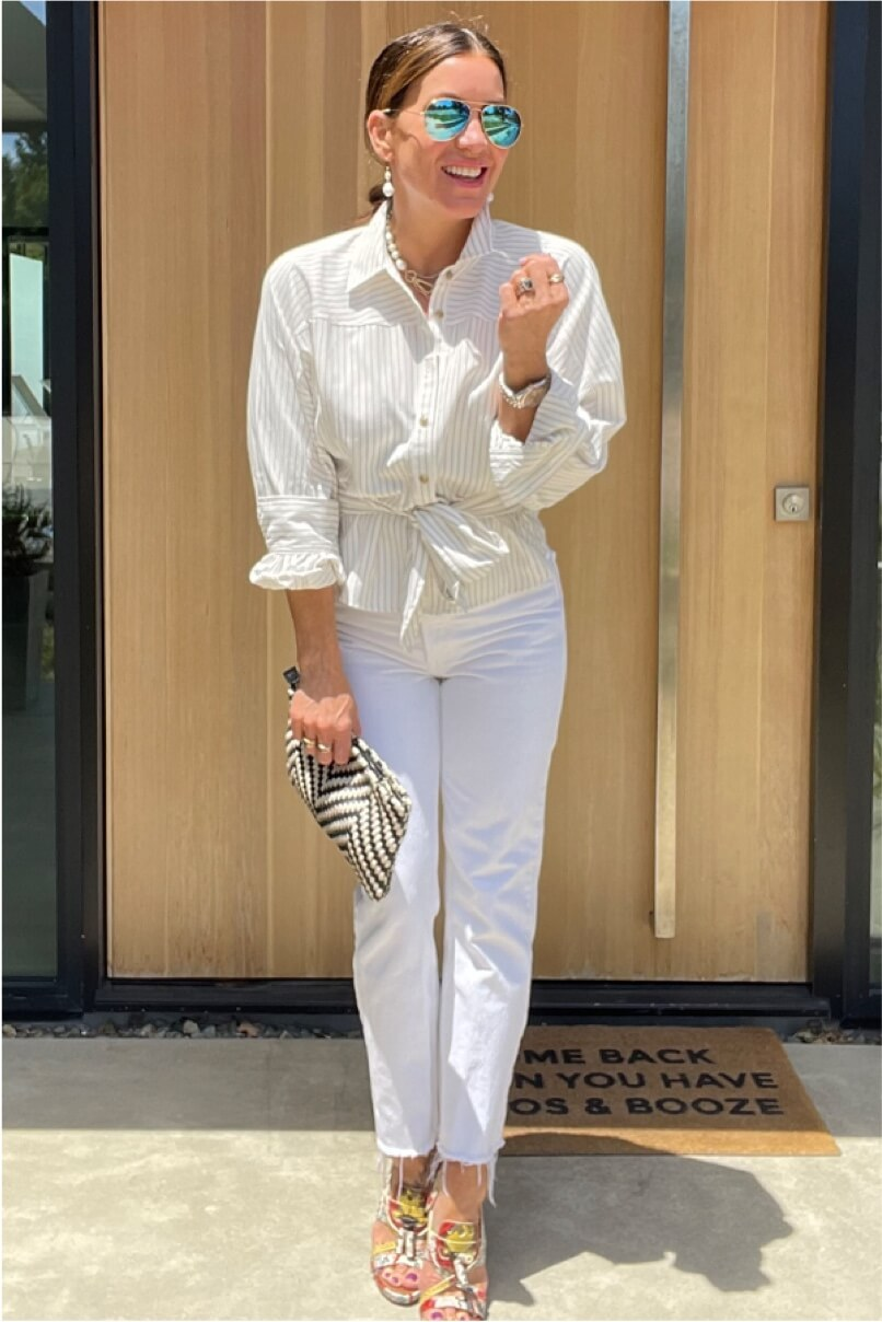 Kat Woodside, Chief Design Officer models her outfit of the day featuring the Tied-Up Shirt in Taupe Stripe and statement accessories