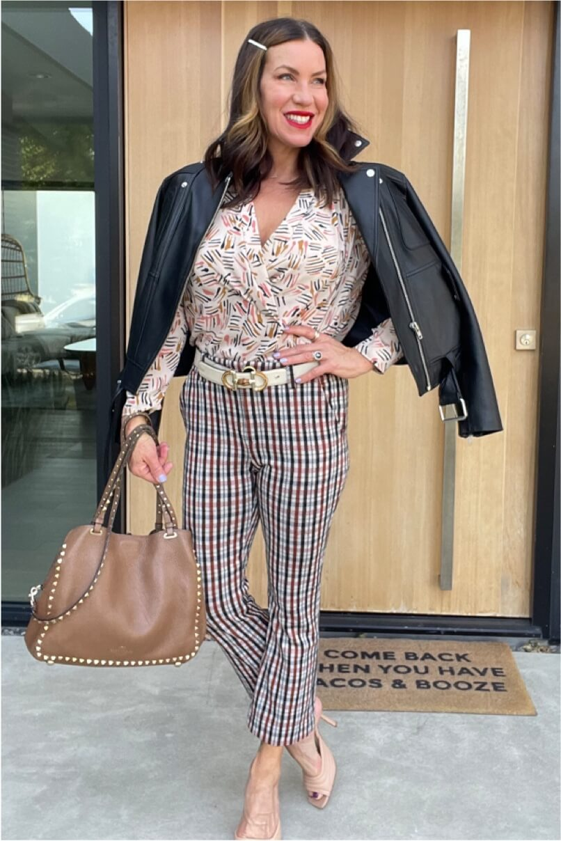 Kat Woodside, Chief Design Officer models her outfit of the day featuring the Marni Blouse in Line Art Print and Jazzy Kick Flare in Toffee Plaid