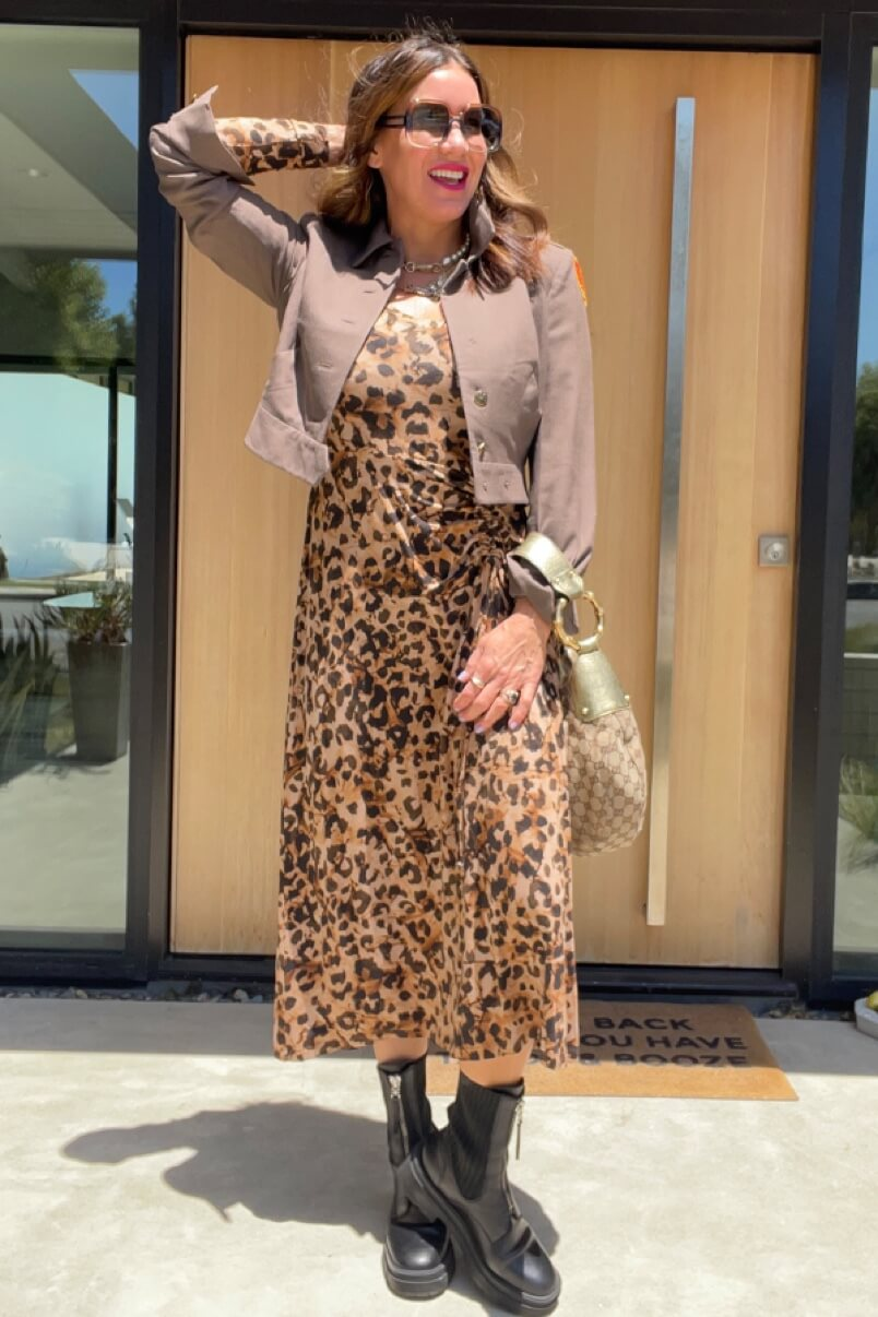 Kat Woodside, Chief Design Officer models her outfit of the day featuring the Selma Dress in Skin Print and statement accessories.
